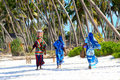 Zanzibar women on sandy beach Stock Image