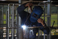 Zap man spot welding temporary framework in new dairy Stock Photos