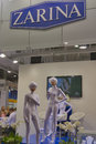 Zarina jewelry house booth presenters in white closes work on during spring jeweler expo exhibition at kyivexpoplaza exhibition Stock Images