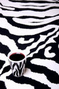 Zebra cup on zebra carpet Stock Photography