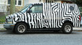 Zebra painted gmc safari van brooklyn ny july in brooklyn on july was in production in and was assembled in baltimore Stock Image