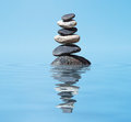 Zen balanced stones stack in lake  balance peace silence concept Royalty Free Stock Photo