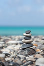 Zen balanced stones stack meditation background close up on sea beach Royalty Free Stock Photography