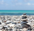 Zen balanced stones stack meditation background close up on sea beach Royalty Free Stock Photos