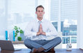 Zen businessman doing yoga meditation with hands joined Stock Photos