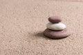 Zen garden sand waves and rock sculptures figures Stock Photography