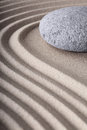 Zen garden spa meditation stone background japanese pattern of sand and stones with curved lines for balance and relaxation Royalty Free Stock Photography