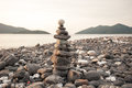 Zen meditation background balanced stones stack close up on sea beach thailand Royalty Free Stock Images