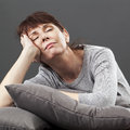 Zen relaxation for serene 50s beautiful woman napping Royalty Free Stock Photo