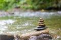 Zen rock pile over water Stock Photography