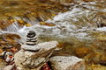 Zen rocks placed near a river Stock Photo