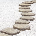 Zen stone path in a japanese garden Royalty Free Stock Images