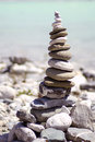 Zen stone tower children made with blue water in background Stock Photography