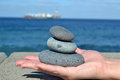 Zen stones in hand stacked on top of one Royalty Free Stock Photo