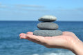 Zen stones in hand stacked on top of one Royalty Free Stock Photos