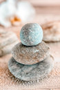 Zen stones at a marine spa carefully balanced and stacked naturally rounded water worn conceptual of spirituality therapy wellness Royalty Free Stock Photos