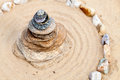 Zen stones pyramid on sand Stock Photography