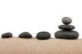 Zen stones pyramid on sand beach, meditation, concentration, relaxation, harmony, balance Royalty Free Stock Photo