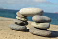 Zen stones stacked with ocean background Royalty Free Stock Image