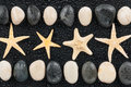 Zen stones and starfish with water drops space for text Stock Photo
