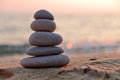 Zen stones at sunset stacked on the beach Royalty Free Stock Photo