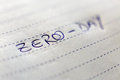 Zero day technical term written in blue ink on white lined paper Stock Photography