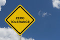 Zero tolerance warning sign an american road with words with blue sky Royalty Free Stock Photo
