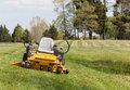 Zero turn lawn mower on turf with no driver Royalty Free Stock Photography