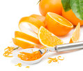 Zest of orange in white bowl fruits and zester on white background Royalty Free Stock Photography