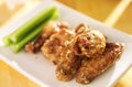 Zesty garlic parmesan chicken wings close up photo of a plate of Stock Image