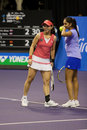 Zheng Jie/Mirza Sania showdown of Champions Tennis Stock Photo