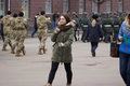 Zhytomyr, Ukraine - February 26, 2016: Girl on Military military parade, rows of soldiers