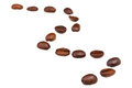 Zigzag pattern from many roasted coffee beans line with focus foreground Stock Images