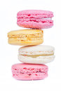 Zigzag row of sweet colorful macaroons on white background. Royalty Free Stock Photo