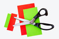 Zigzag scissor on the color card green and red with white background Royalty Free Stock Photos