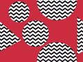 Zigzag seamless pattern with black and red color. Abstract geometric background with circles. Vector