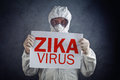 Zika virus concept medical worker in protective clothes showing alertness poster Royalty Free Stock Photography
