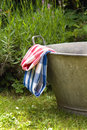 Zinc tub in the garden with blue and red checkerd table cloths on it Royalty Free Stock Photo