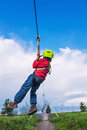 Zip line young boy on in adventure park Royalty Free Stock Images