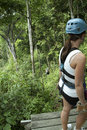 Zip lining costa rica woman watching someone glide on a zipline Royalty Free Stock Images