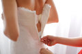 Zipper of wedding dress bridesmaids fasten with Royalty Free Stock Images