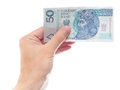 Zloty hand holding a fifty banknote isolated on white Stock Image