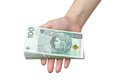 Zloty hand taking a stack of polish Royalty Free Stock Photo