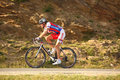 Zolt Der cyclist from Serbia riding uphill to Paltinis Stock Image