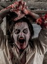 Zombie attack photo of a hungry covered with blood about to you Stock Image