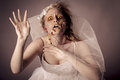 Zombie bride undead young woman as a shot in studio Royalty Free Stock Images