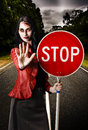Zombie girl holding stop sign at dead end Royalty Free Stock Photo