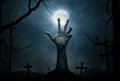 Zombie halloween wallpaper dead hand coming out from the soil Stock Image