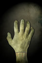 Zombie hand background on grunge wall useful as poster for halloween Stock Photos