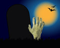 Zombie hand coming out of the grave useful for halloween Stock Photo